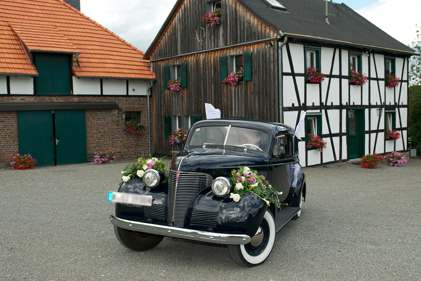 Decorated vintage car for wedding, marriage and wedding in the Bergisches Land