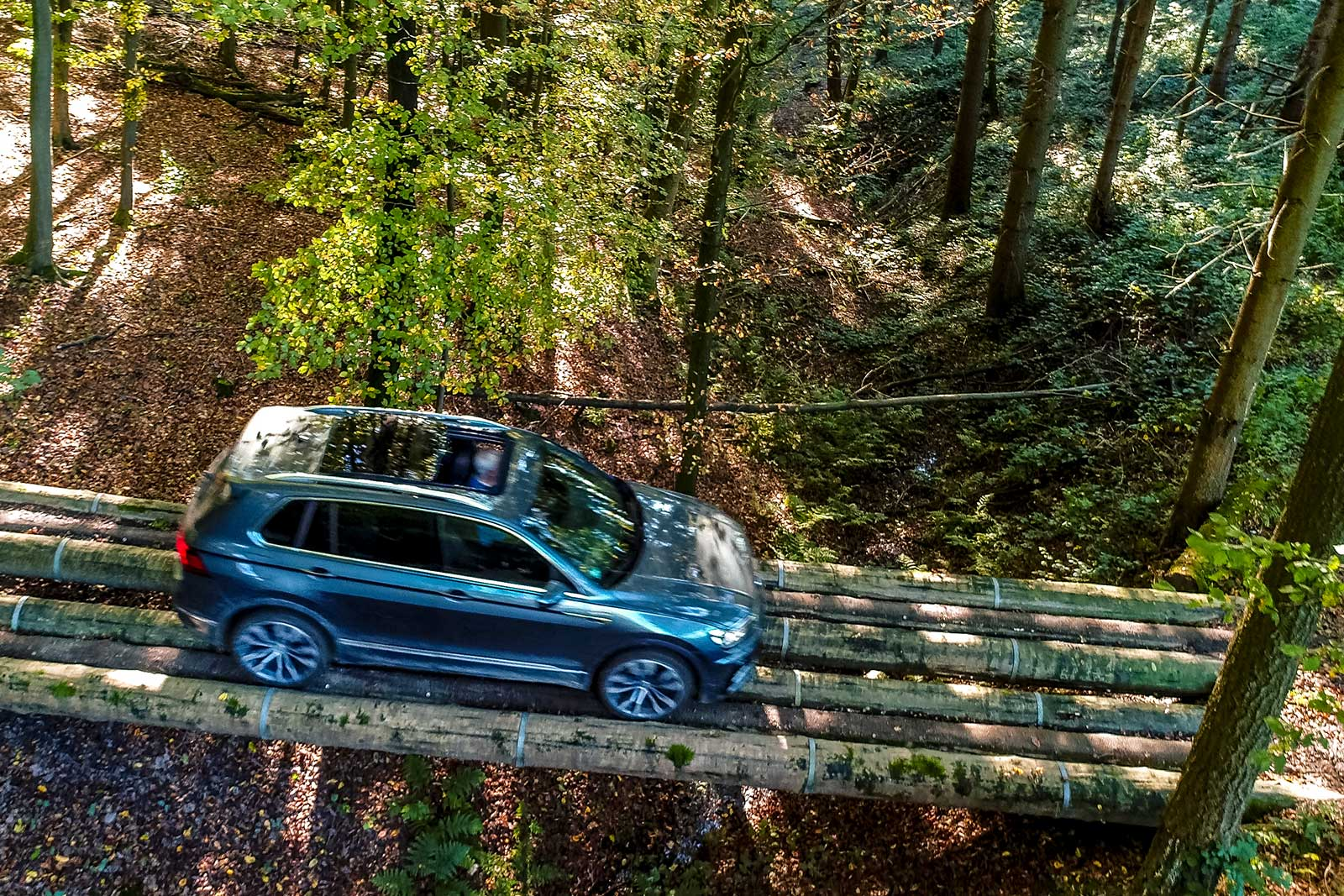 Test vehicle drives over tree trunks in our forest